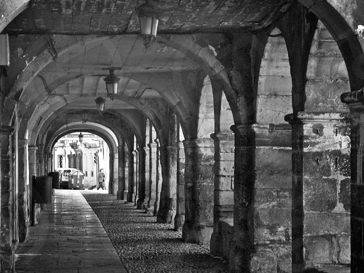 arched stone outdoor hallway photo