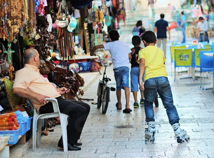 boy's walking in the street photo