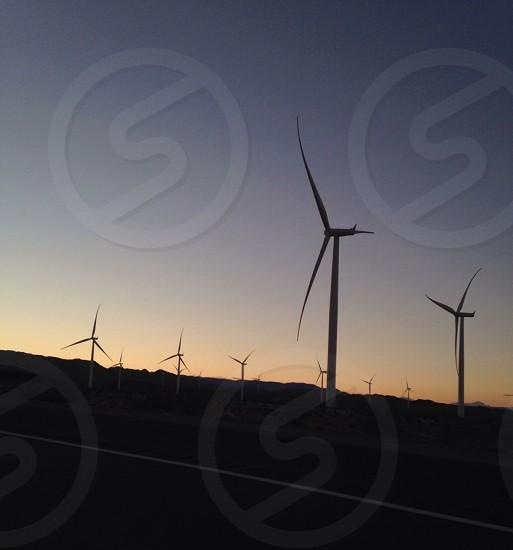 silhouette of wind turbine at photo