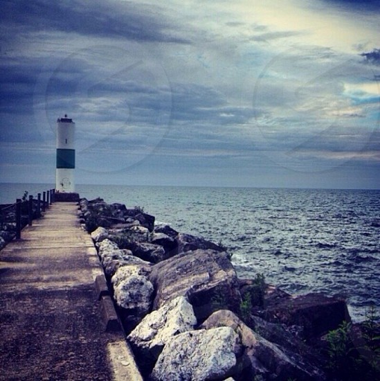 lighthouse and white clouds photography  photo