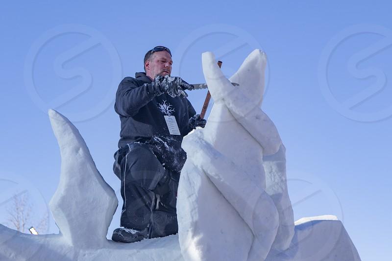 Artist sculpting ice at Breckenridge Colorado Ice Festival. photo