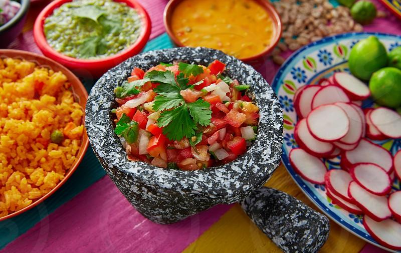 Pico de gallos mexican sauce with rice and salsas photo