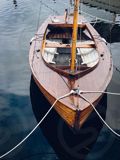 Boating lifestyle  wooden boat harbor rope floating photo