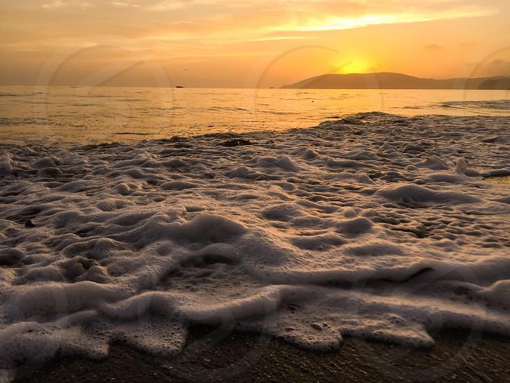 Shell Beach Central Coast San Luis Obispo California beach beaches ocean sunset summer tide sand foam waves. photo