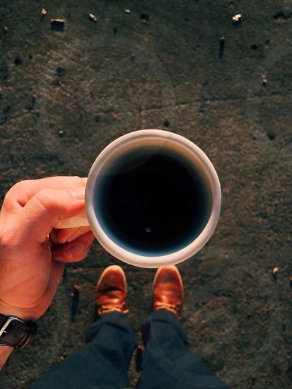 Coffee fall hand pov point of view mug morning photo