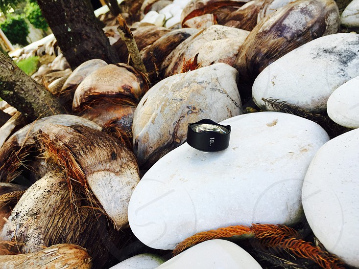 iPhone photography mobile phone lens coconut husk stones. photo