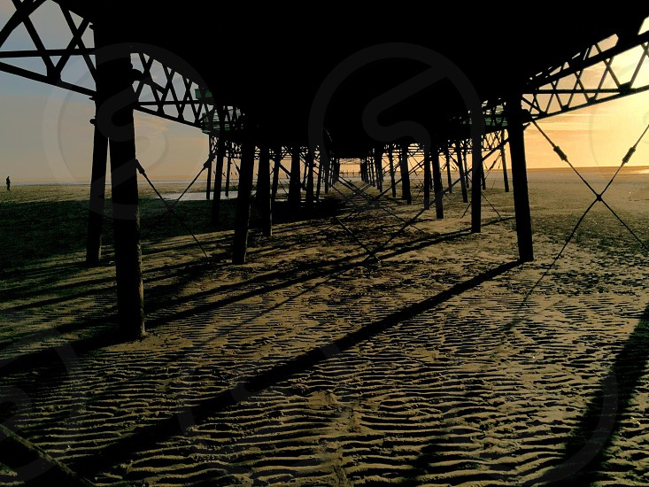 Taken under the pier in Blackpool uk at sunset photo
