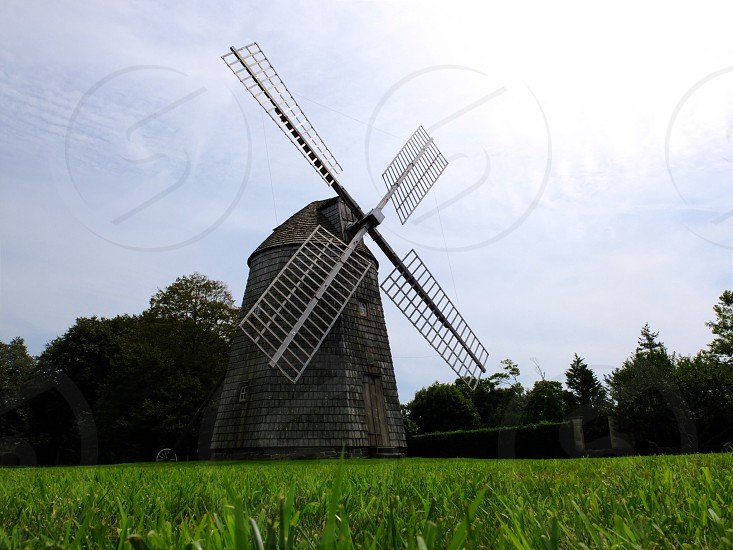 large windmill in a green field photo