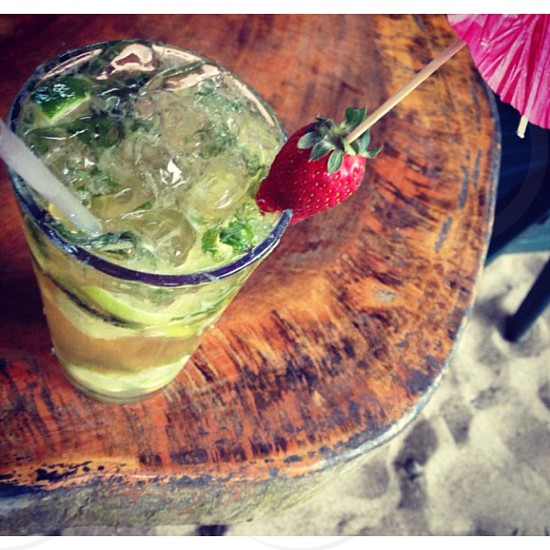 strawberry on pint glass photo