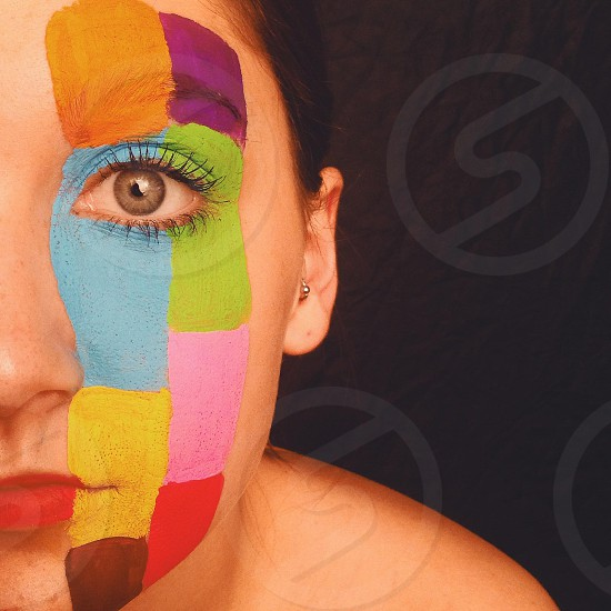 multicolored face paint photo