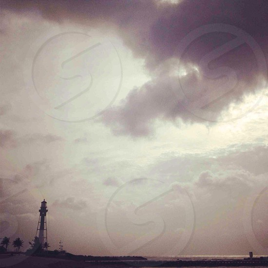 black lighthouse photography photo
