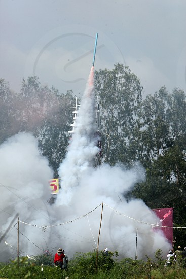 a start of a rocket at the Bun Bang Fai Festival or Rocket Festival in the City of Yasothon in the Region of Isan in Northeast Thailand in Thailand.