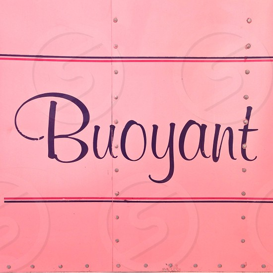 buoyant printed pink textile photo