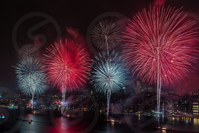 red and white fireworks over cityscape under night sky photo