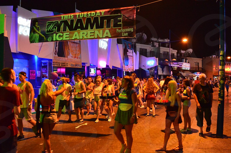 group of people participate on Dynamite Ice Arena marathon during night photo