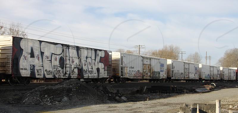 Atomik - Graffiti on a refrigerated train car. Photo taken in Fife WA. photo