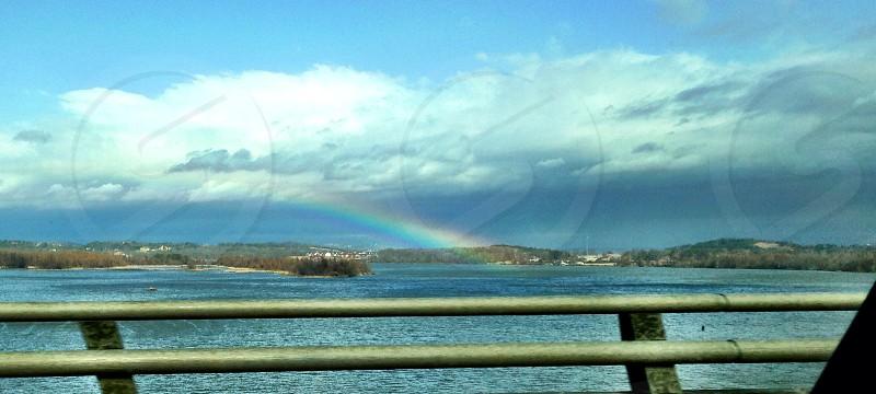 rainbow over mountain view photo
