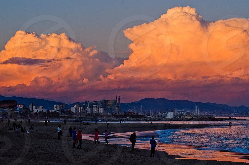 Pink and white cumulus clouds photo