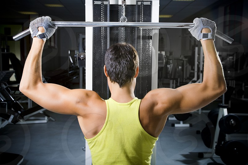 power; handsome; sweat; sweating; health club; exercising; muscular; sports; healthy lifestyle; human arm; heavy; fitness; endurance; muscle; arm; weight; training; caucasian; man; male; guy; sports clothing; active; adult; exercise; activity; sport; muscled; sporting; work out; gym; working out; physical fitness; workout; sports clothes; endure; action; muscular body; muscular build; activities; weightlifting; weight lifting; pound; body building; bicep; mass; leisure; body sculpting; italian photo