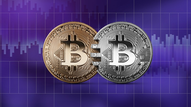 Coins bitcoin gold and silver coins on an ultraviolet background. The concept of blockchain technology and money transfers. Mastercard analog concept. Cryptocurrency and blockchain trading concept. Can be used for video or site cover photo