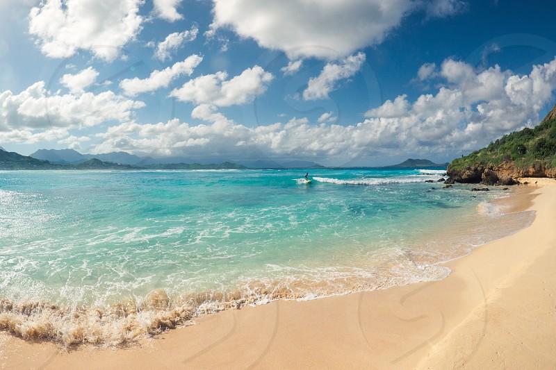 Surfing in Hawaii landscape blue sky  photo