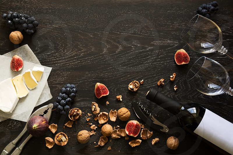 walnuts figs grapes cheese brie red wine wineglass food drink low key dark wooden isabella photo