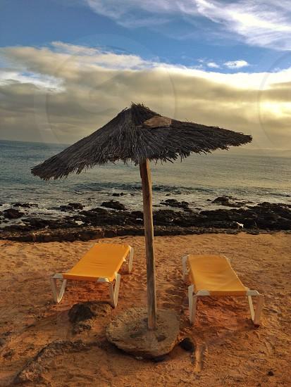 Orange beach sun beds sun lounger parasol sand sea relax photo
