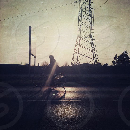 person riding on bicycle photo