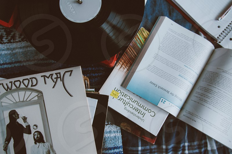 white and blue book beside black white vinyl record photo