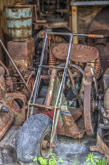 Old Rusty Scooter and other old Antiques photo