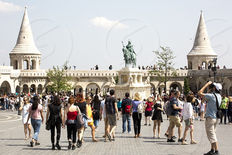 Budapest BD 29.04.2018: Group of tourists visiting the Trinity square in Budapest photo