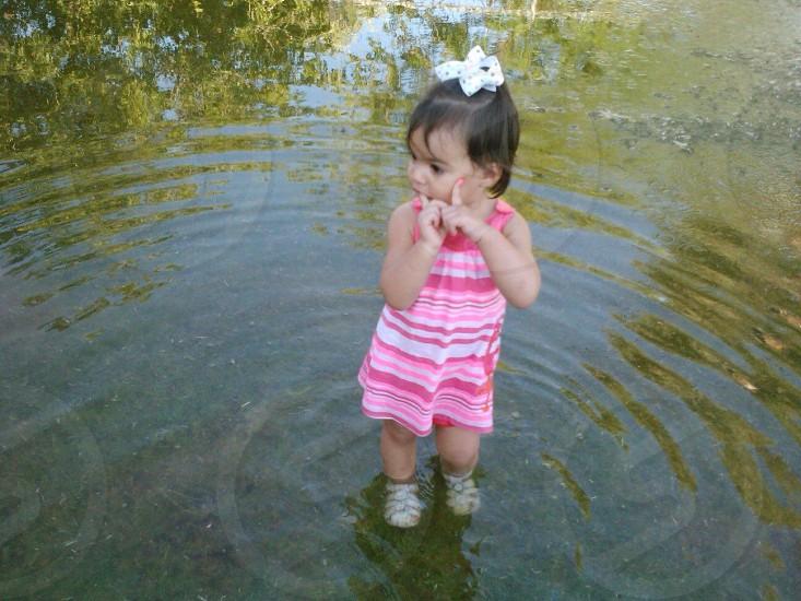 Little girl river cute happy peaceful photo