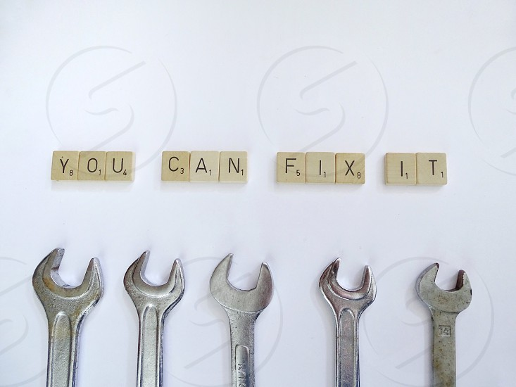 do it words text wrench tools work fixing fix repair hand using tools white background emancipation letters DIY  photo