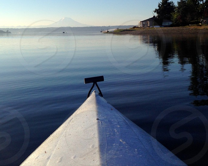 Kayaking water mountain serene triangle bow smooth glassy explore travel boating photo