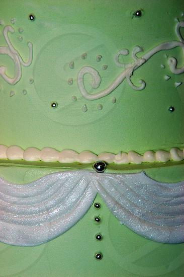 Close up of a green wedding cake photo