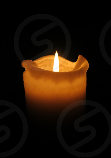 Candle flame black background photo