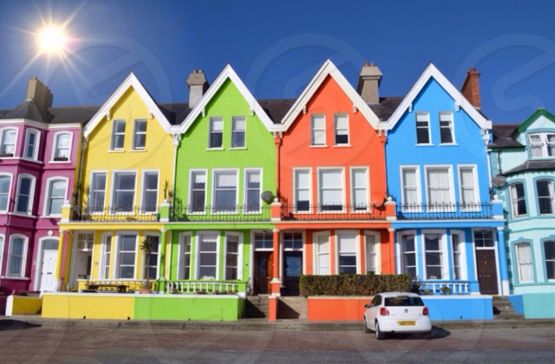 rainbow colored houses on a street photo