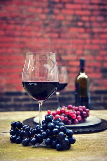 Wine glass. Rustic table. Outdoor. photo