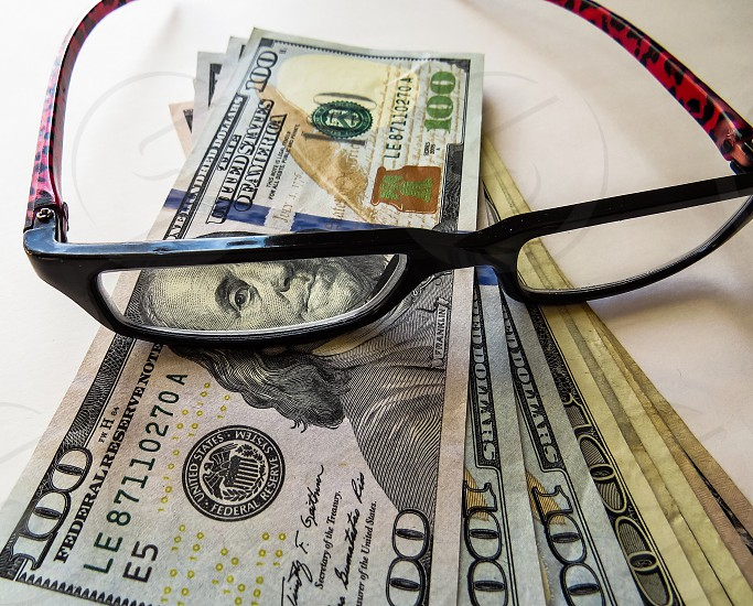Money savings banking closeup glasses photo