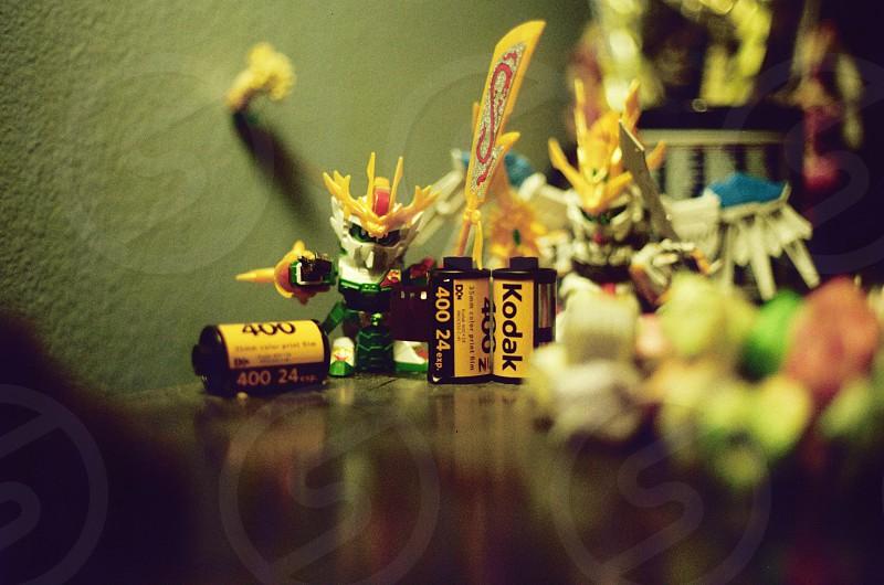 Toys and kodak film rolls on the table photo