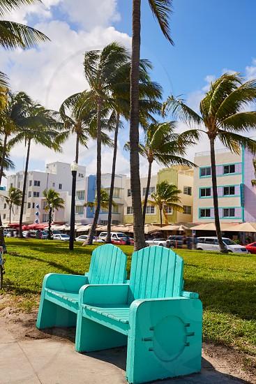 Miami Beach Ocean boulevard Art Deco district in florida USA park turquoise bench photo