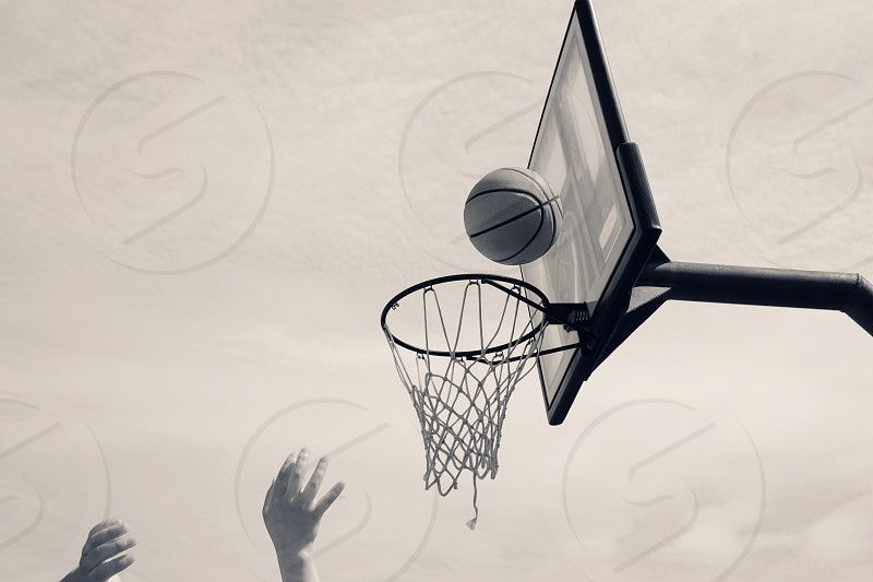 Shooting basketball hoops in black and white. photo