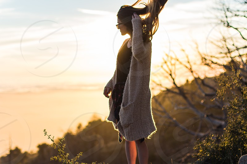 woman on mountain with sunrays photo