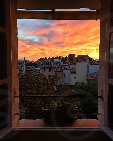 A window looking out to a beautiful sunset in Aix-En-Provence France. photo