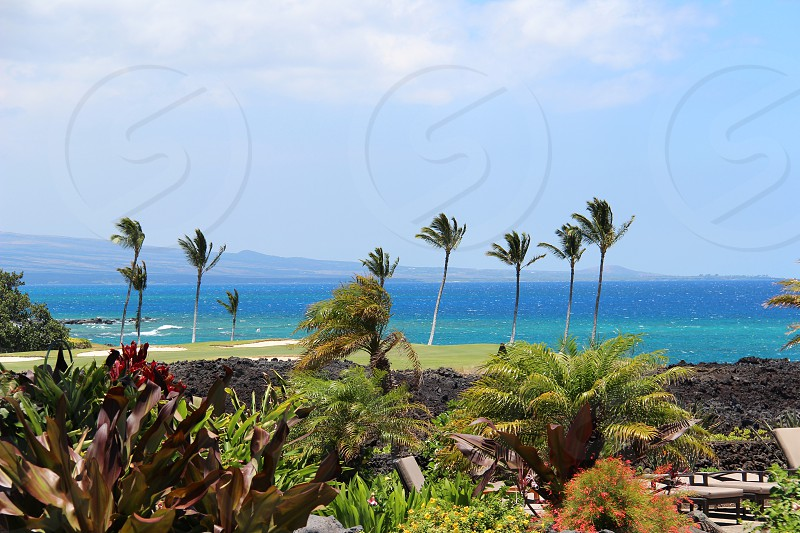 Photo of the coast of the Big Island with Maui in the background. photo