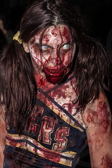 woman in zombie cheerleader costume photo