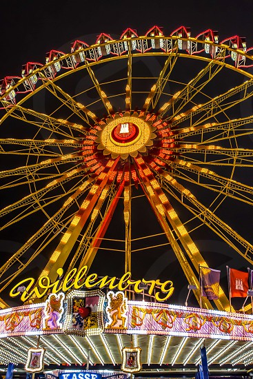 summer fair night wheel ferris german hamburg circle lights steelwork photo