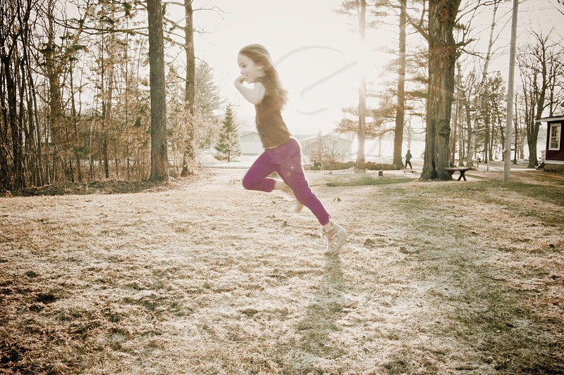 girl running to the forest photo