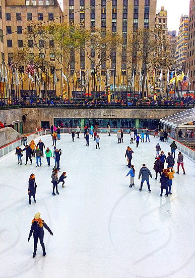Ice-skating at Rockefeller Center! Tourists take in an afternoon of ice-skating during the holiday season!  photo