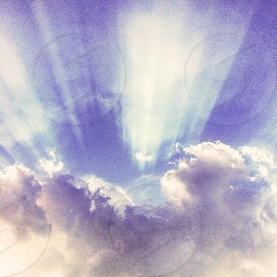 Sun rays over the sky photo